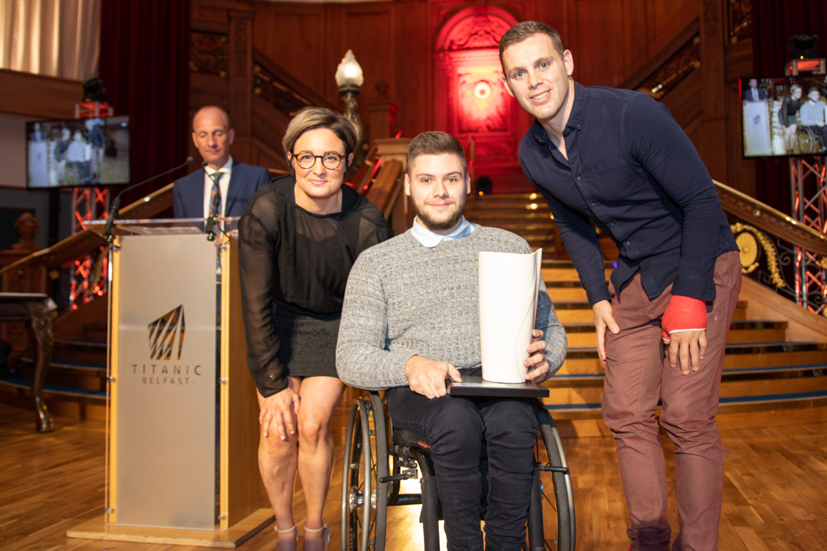 Claire Harris from Esportif with winner Jack Agnew and Darren Cave from Disability Sport NI