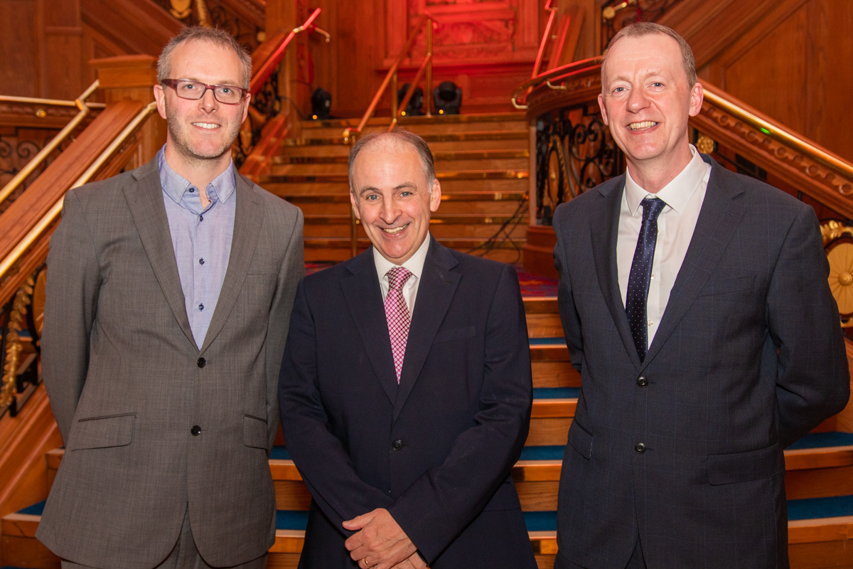 An image of Poolpods Josh Reid with Disability Sport NI's Michael McAteer and Kevin O'Neill