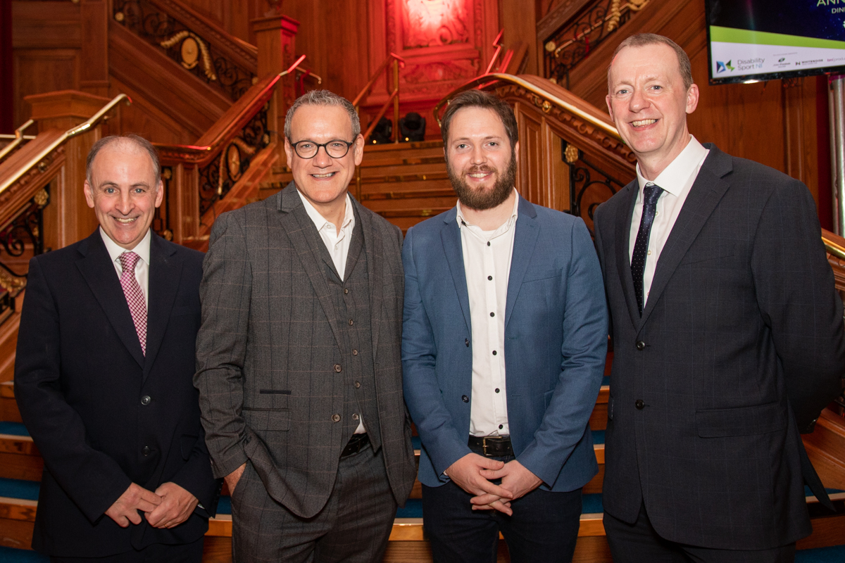 An image of Mark Case and Adam Smyth from Whitenoise with Disability Sport NI's Michael McAteer MBE and Kevin O'Neill