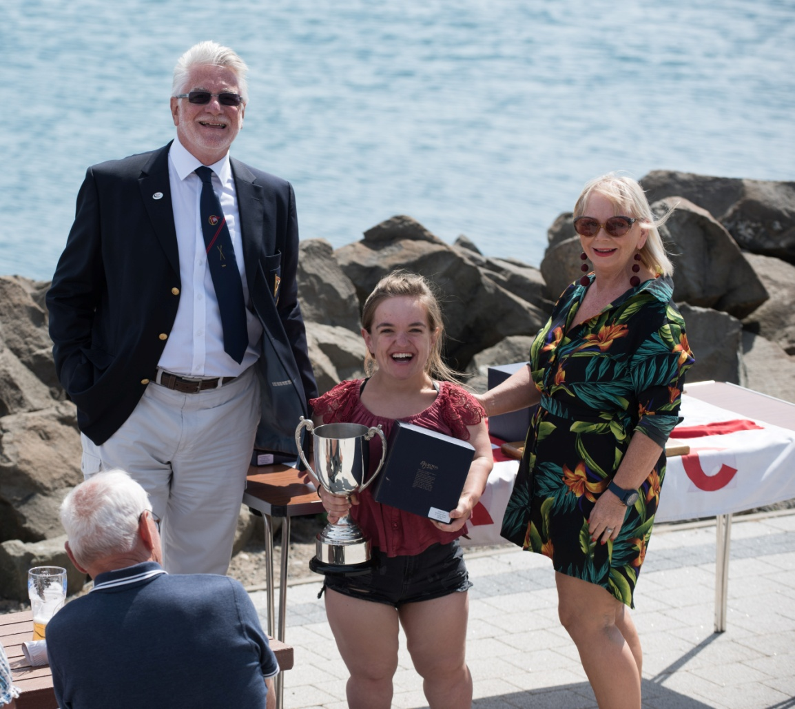 Dave McCabrey, Commodore Carrickfergus Sailing Club with Gina Griffen, winner of the Irish Disabled Sailor trophy and Ruth McCabrey, presenting.