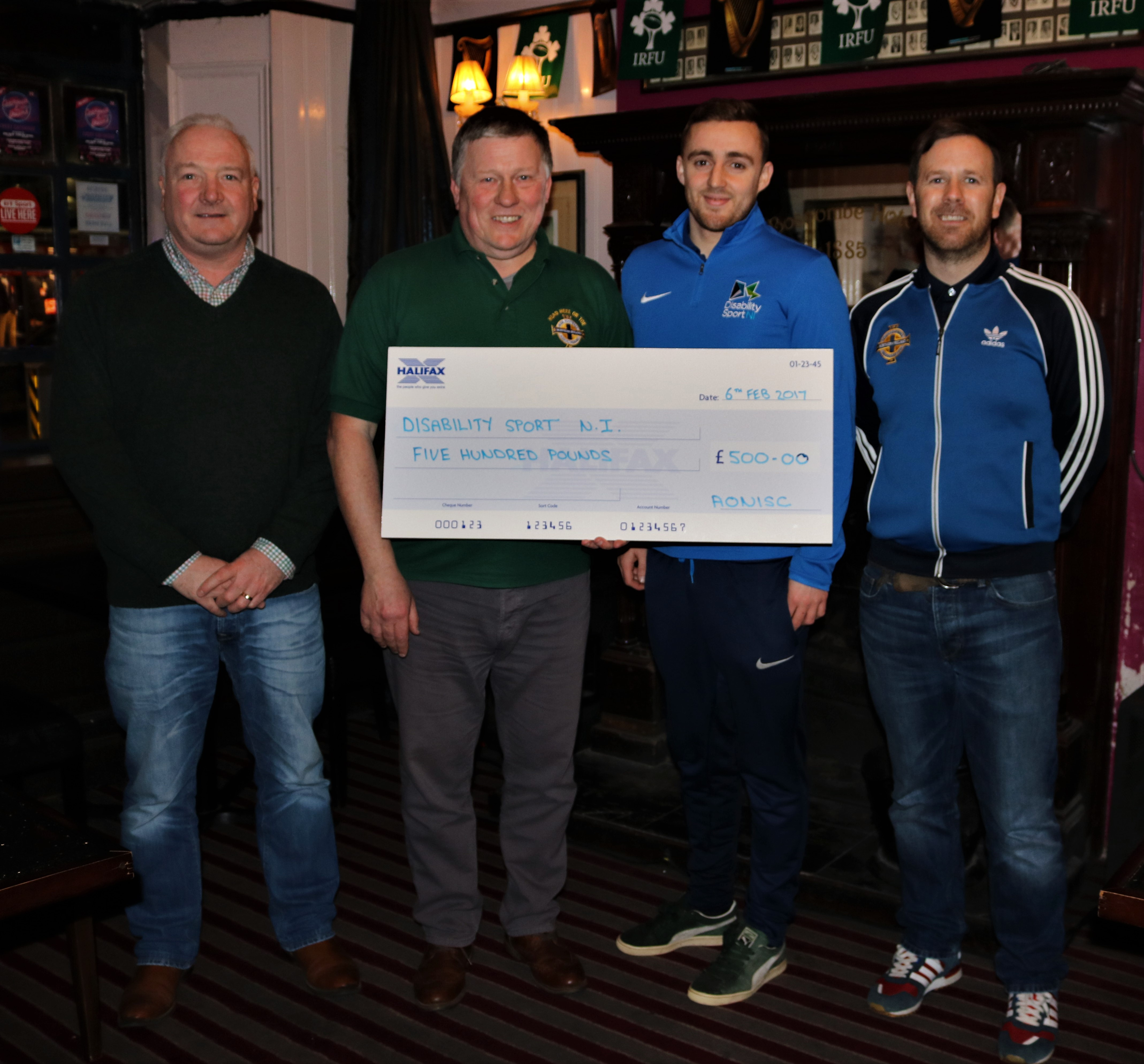 Alan Ferris, Jim Spratt and Stuart Mellon present Mark Montgomery with a large cheque