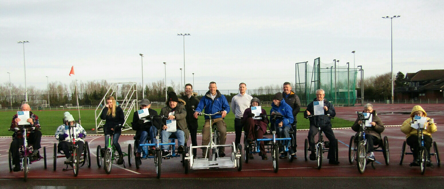 An image of all of the participants lined up in a row with their certificates