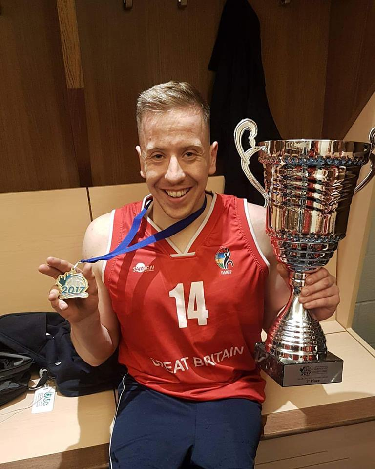 James MacSorley holding the cup after wwinning the U23 Wheelchair Basketball World Championships with Team GB