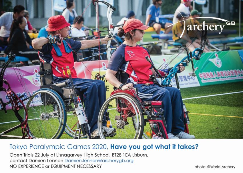 an image of two people who are wheelchair users playing archery
