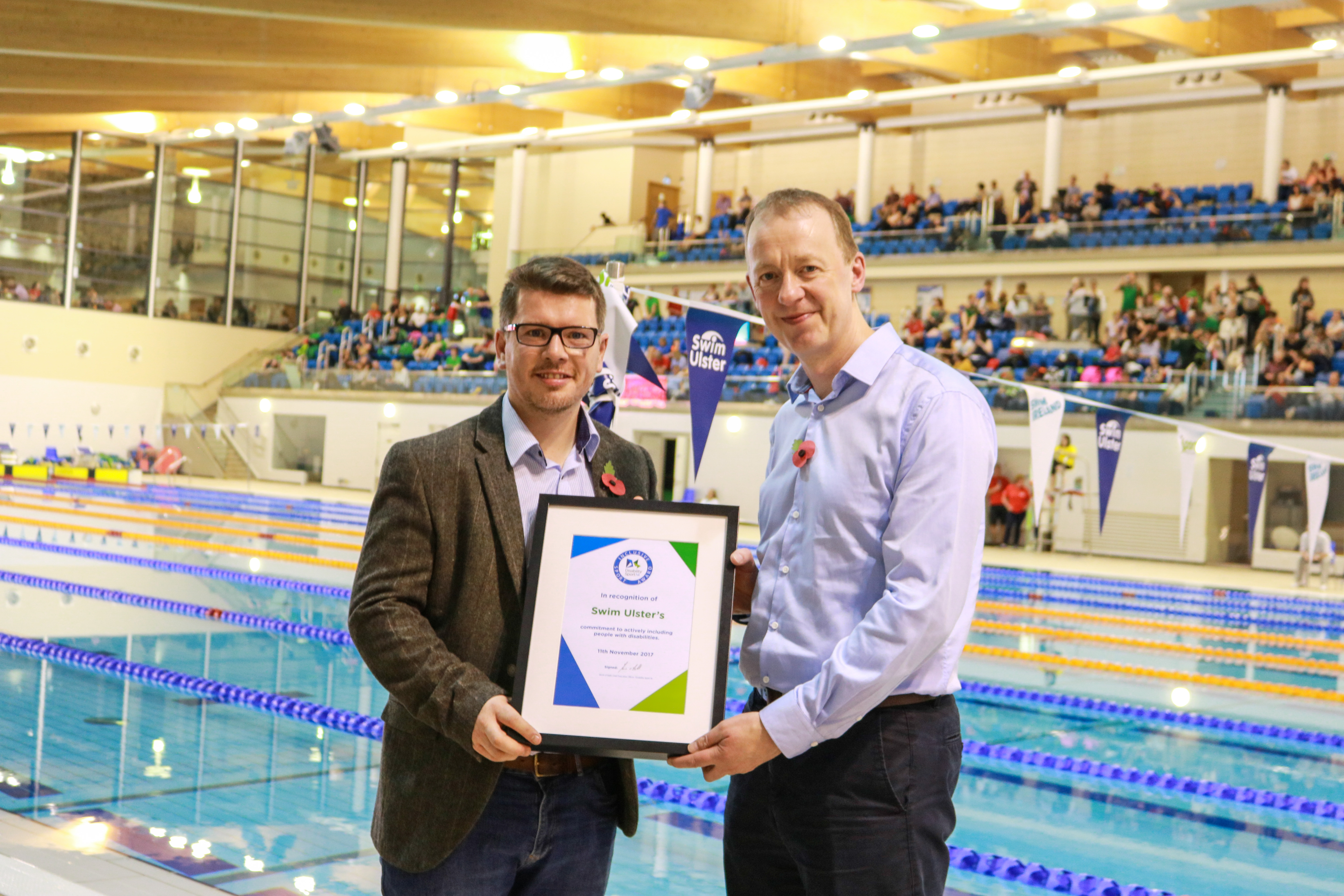 Stephen Cuddy and Kevin O'Neill standing in front of a swimming pool