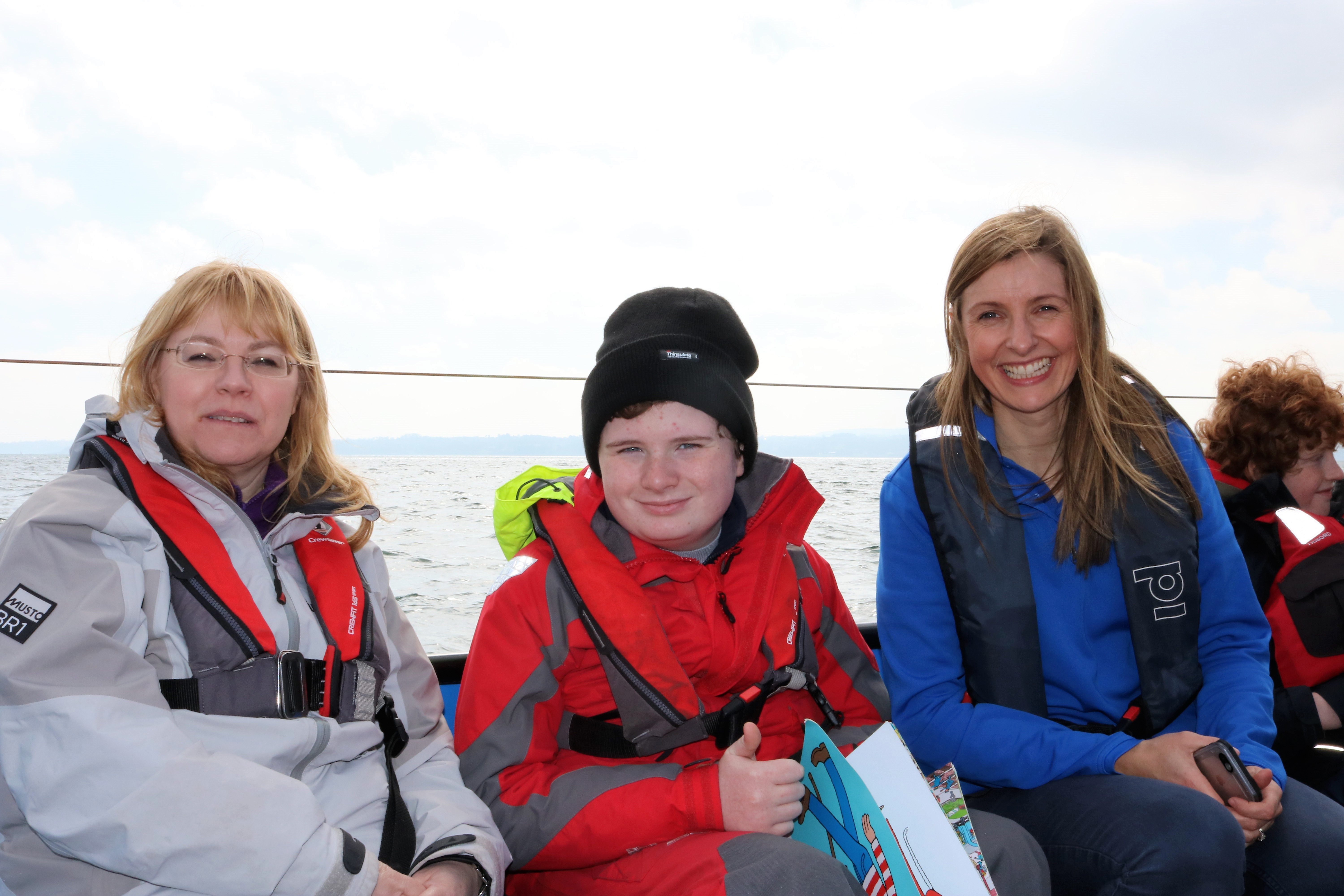 Elaine Reid from Disability Sport NI out on the water with participants from Belfast Lough Sailability