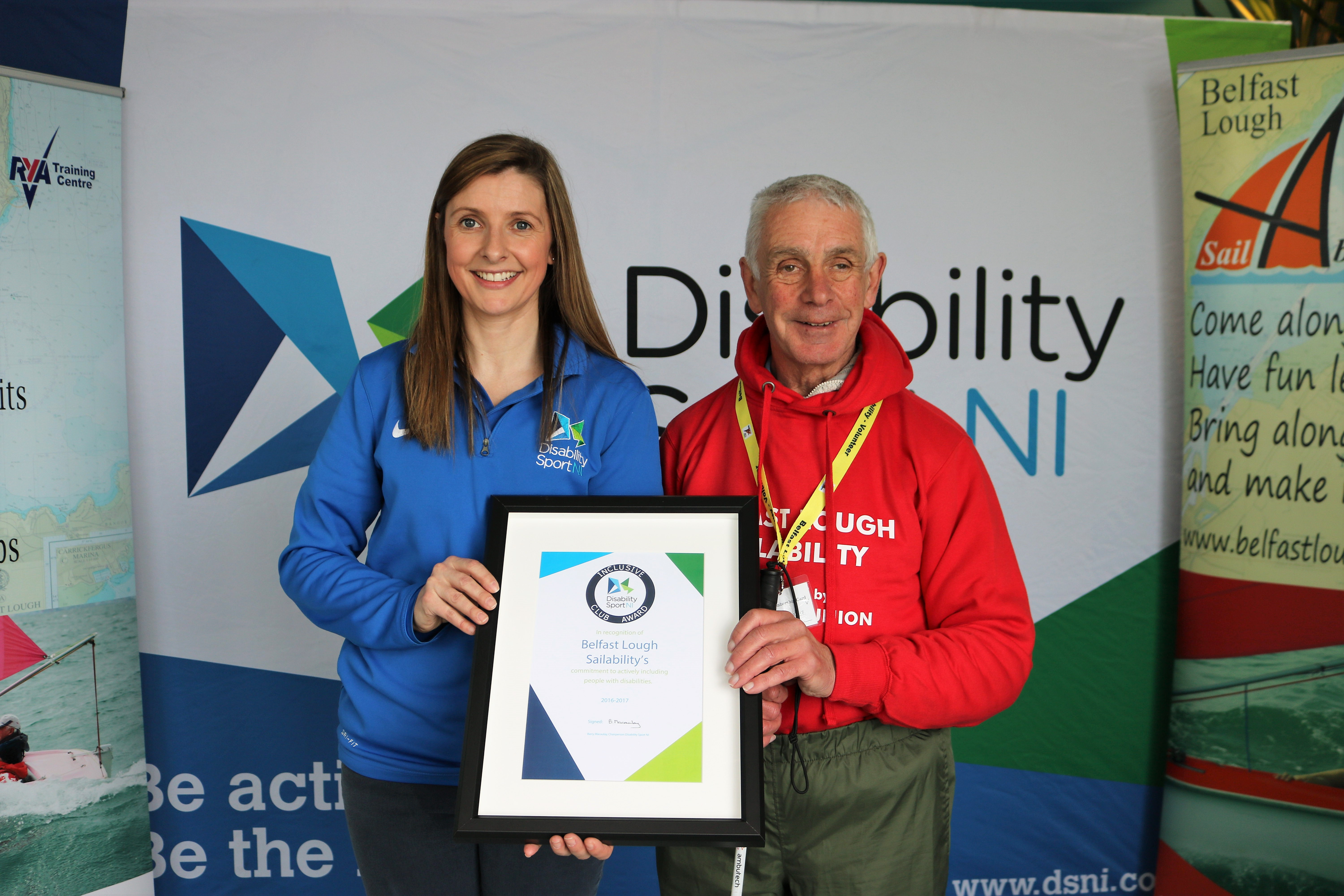 Elaine Reid from Disability Sport NI presents Bill Foster from Belfast Lough Sailability with The Inclusive Club Award.