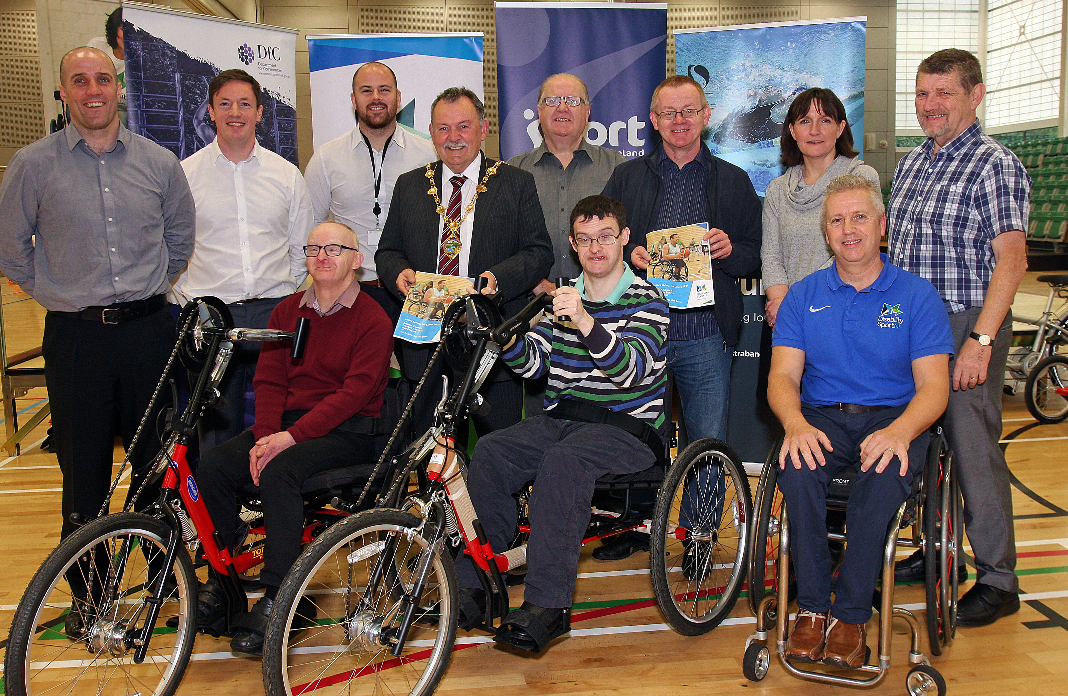Representatives from Derry City & Strabane Council, Sport NI and Disability Sport NI alongside participants using the disability sports equipment