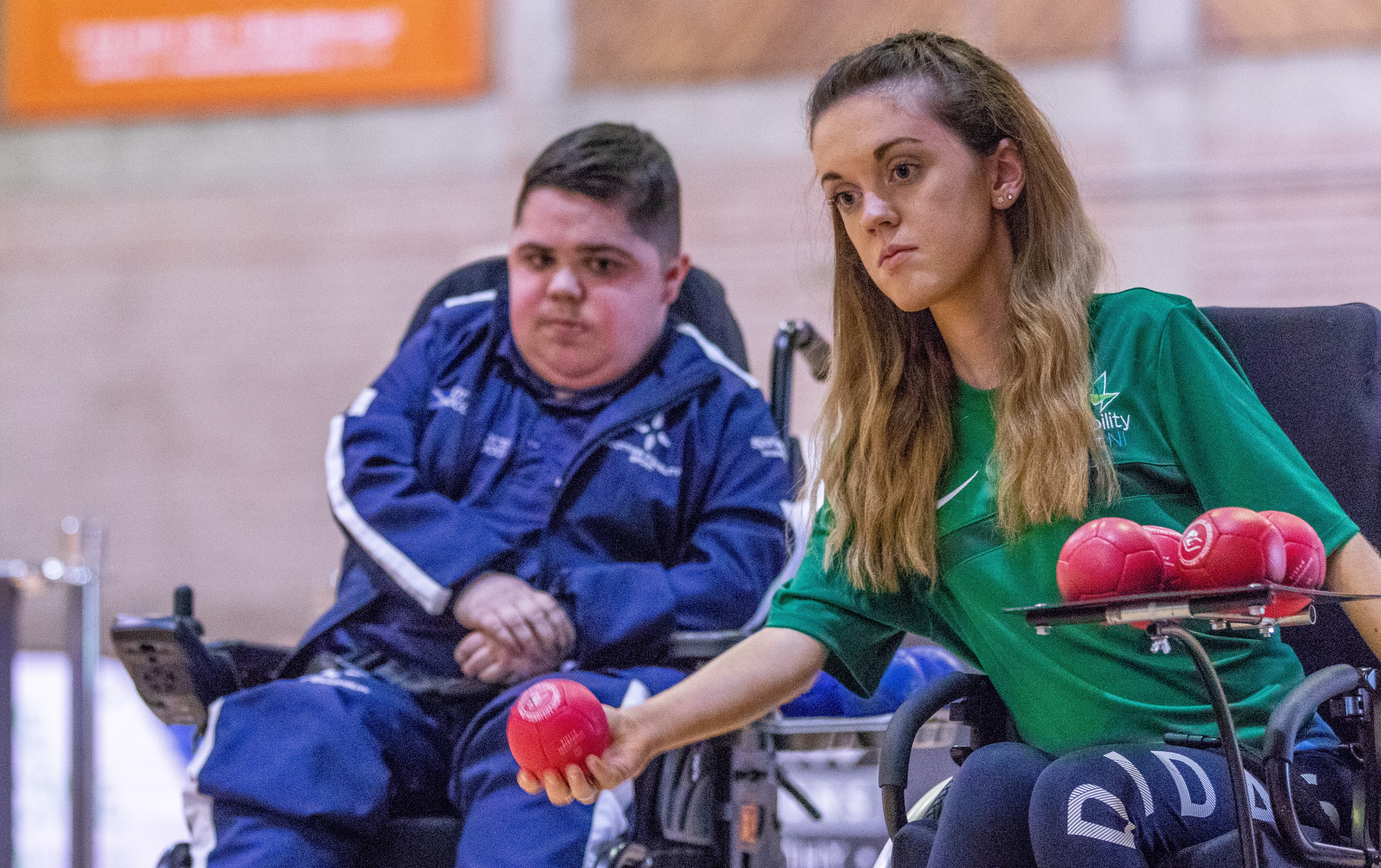 An image of Jayne Milligan about to throw the Boccia ball with her opponent looking on in the background