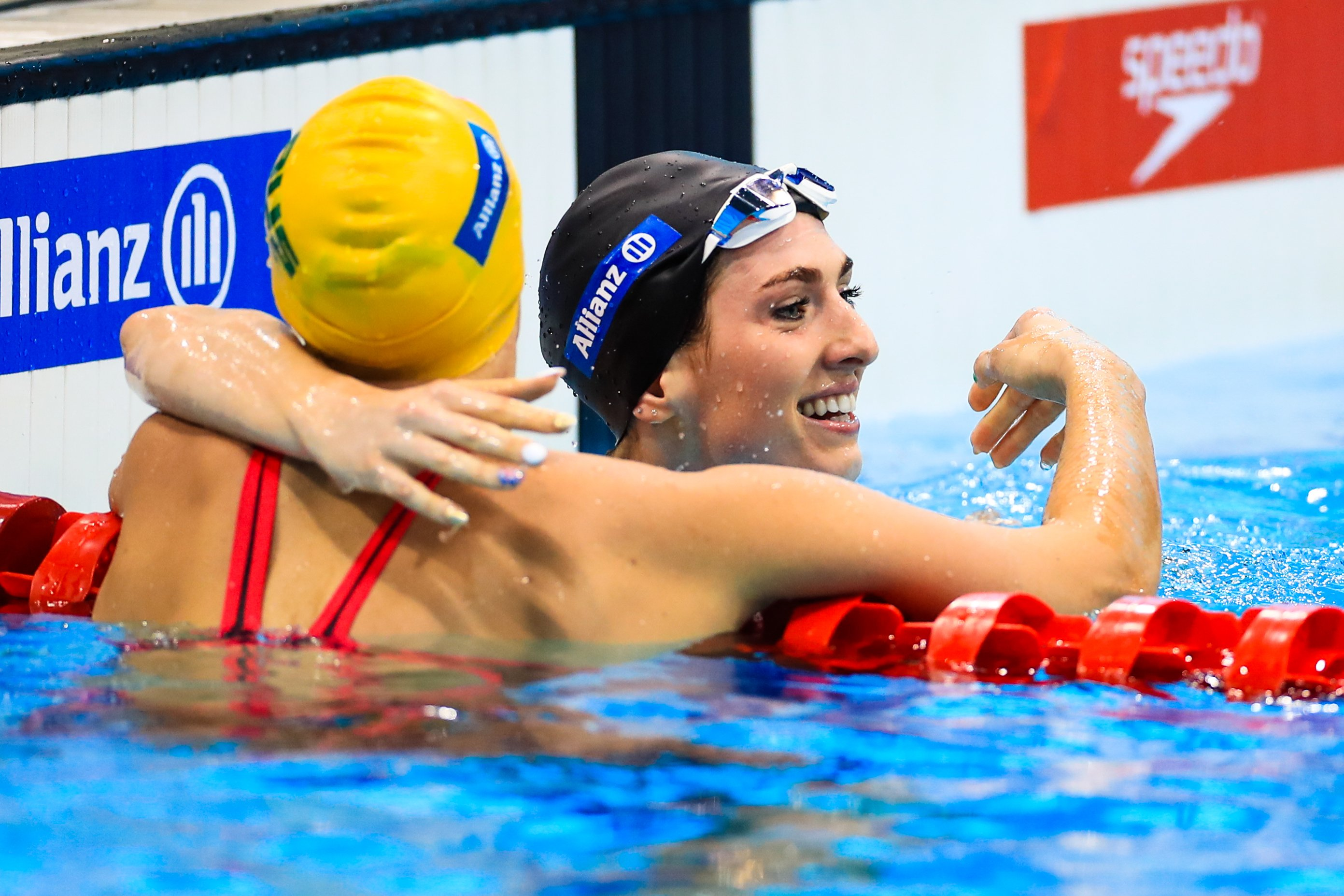 An image of Bethany Firth in the swimming pool after she won hugging her competitor