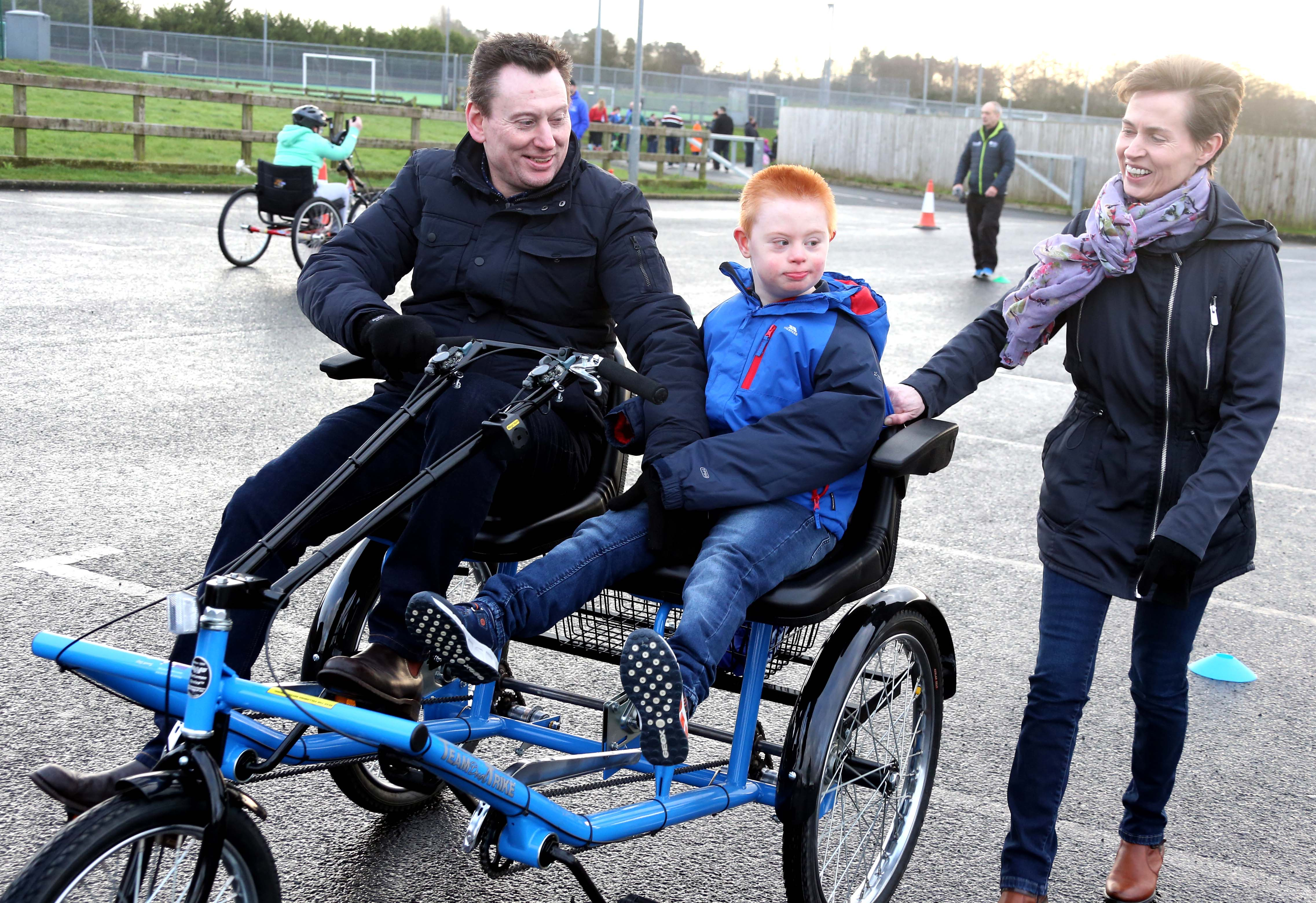 A family taking part in inclusive cycling