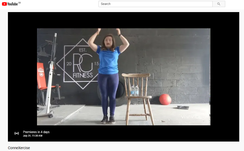 A screenshot showing the video ready to premiere. Rebecca Greenaway is the instructor and the image shows her standing ready to start exercising.
