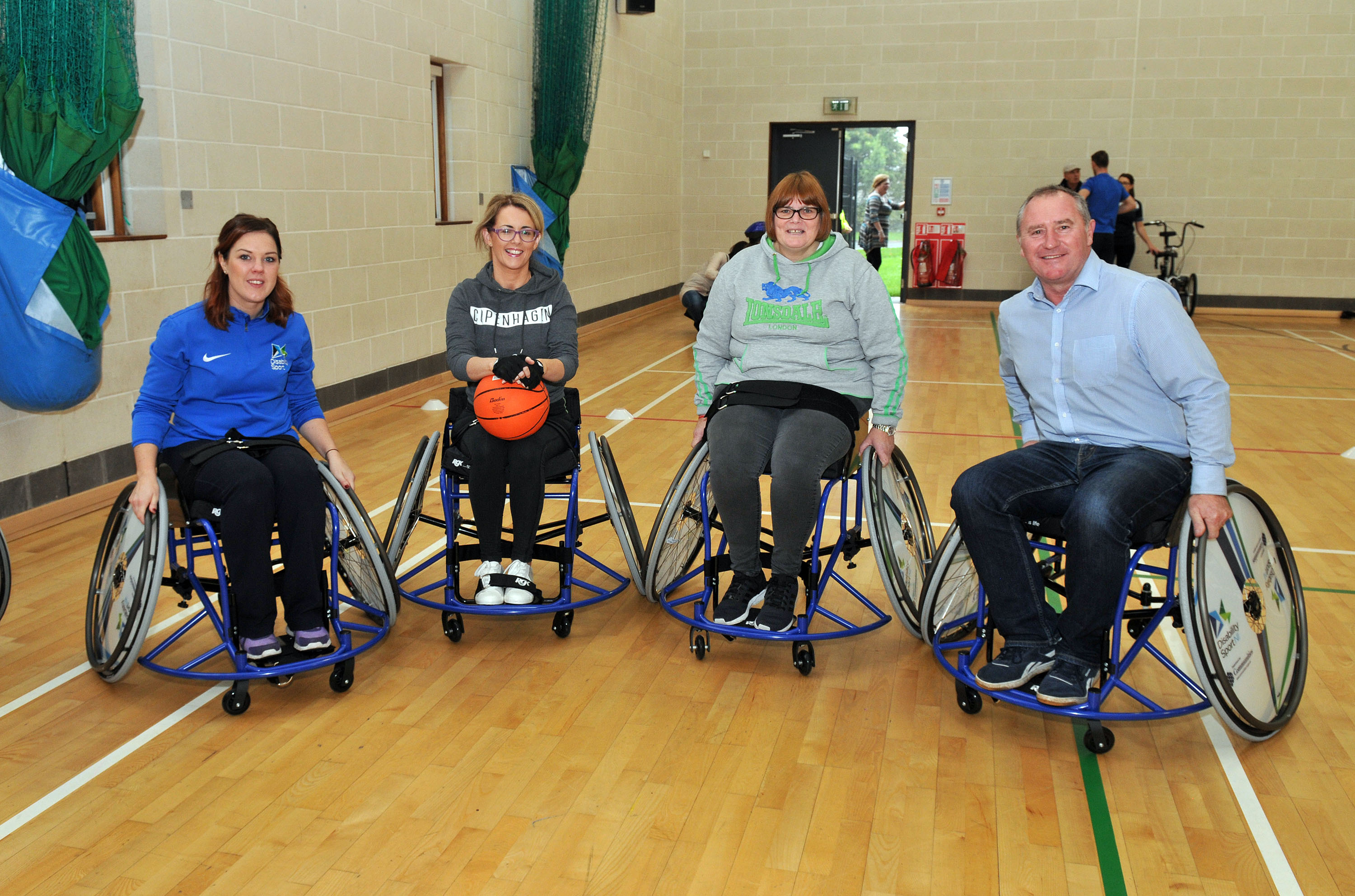2.Colleen Connolly, Disability Sport NI, Julie Wilson, Daryl Cupples and Cllr Declan McAlinden, Chair of the Leisure Services Committee giving wheelchair basketball a go.