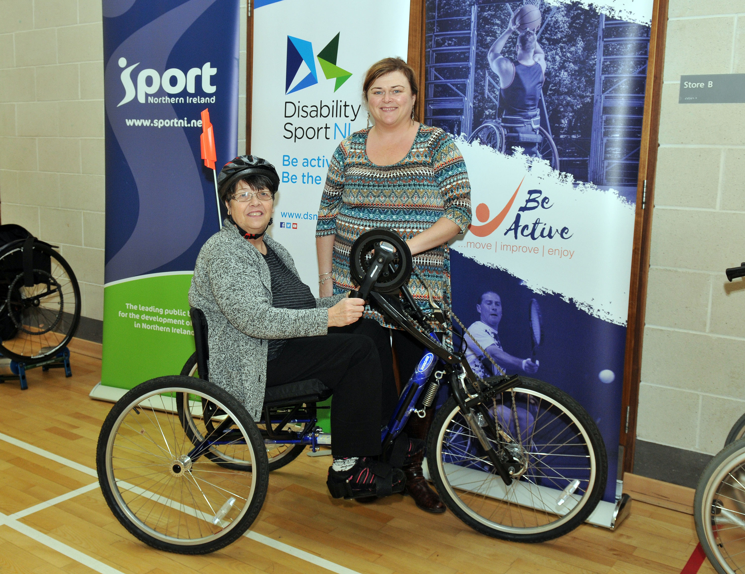 Christine Weir on the hand cycle with Julie Black.