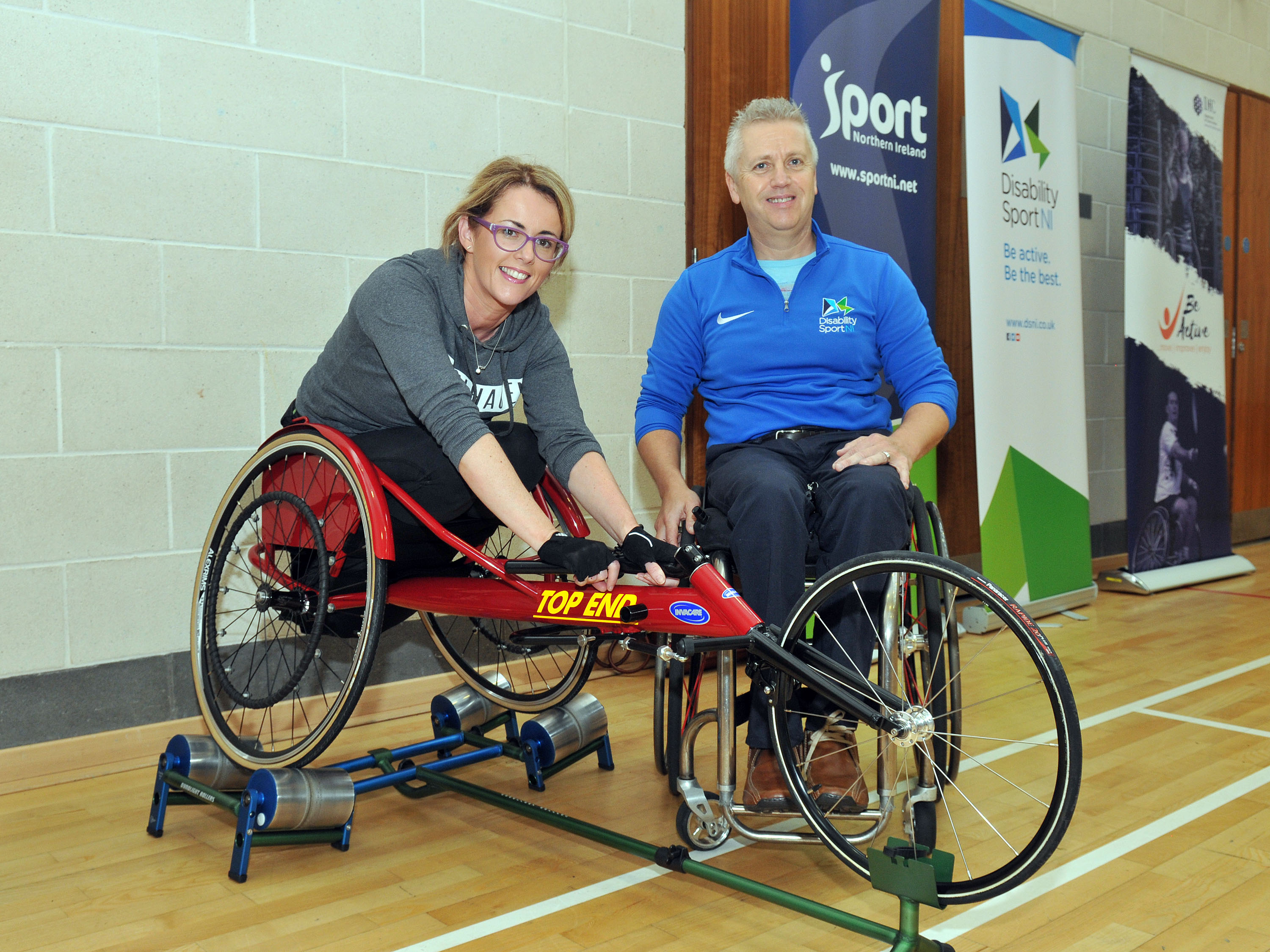 5.	Julie Wilson testing her speed on the track chair with advice from Aubrey Bingham, Disability Sport NI
