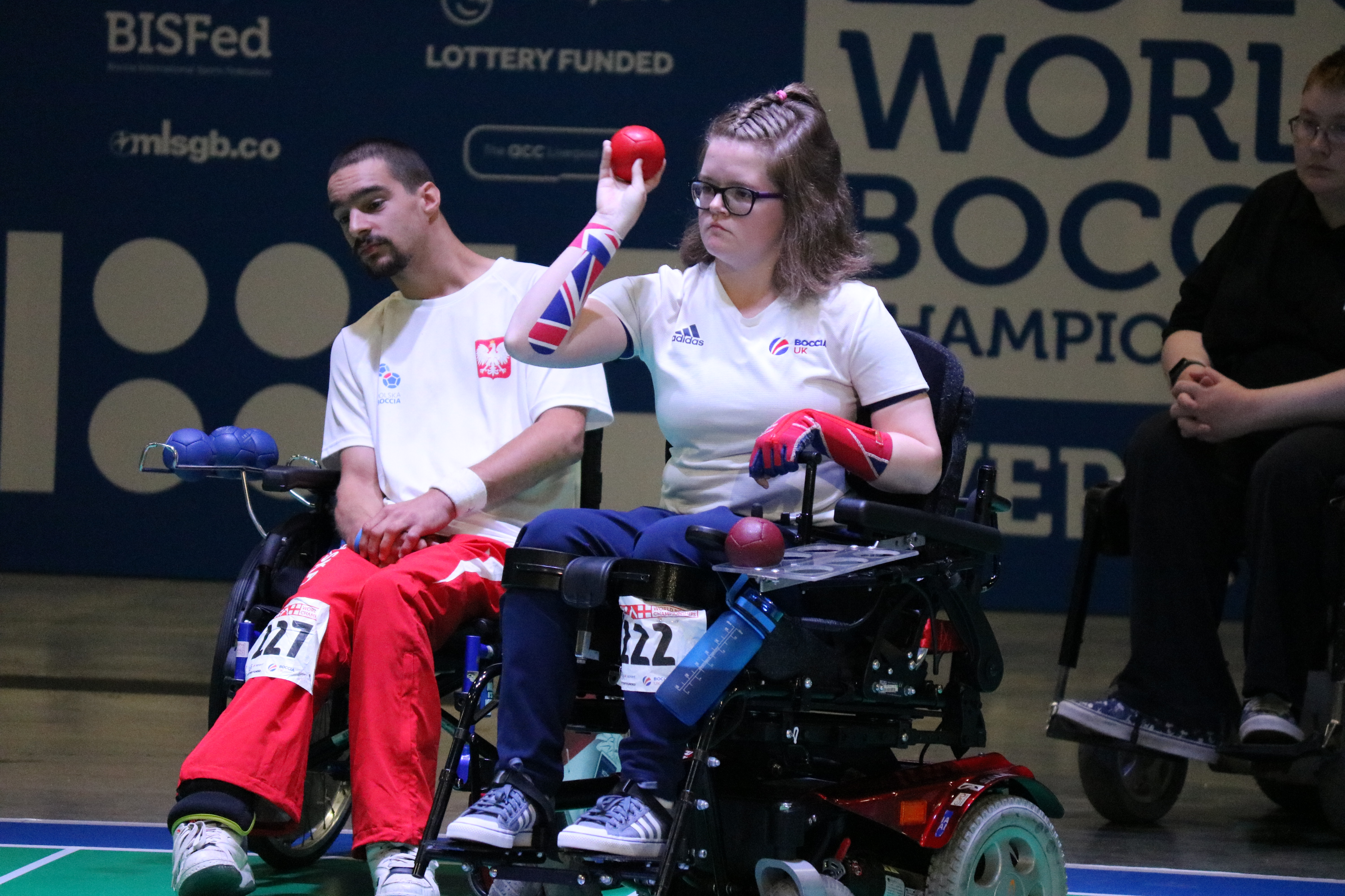 An image of claire in her GB kit about to throw a boccia ball