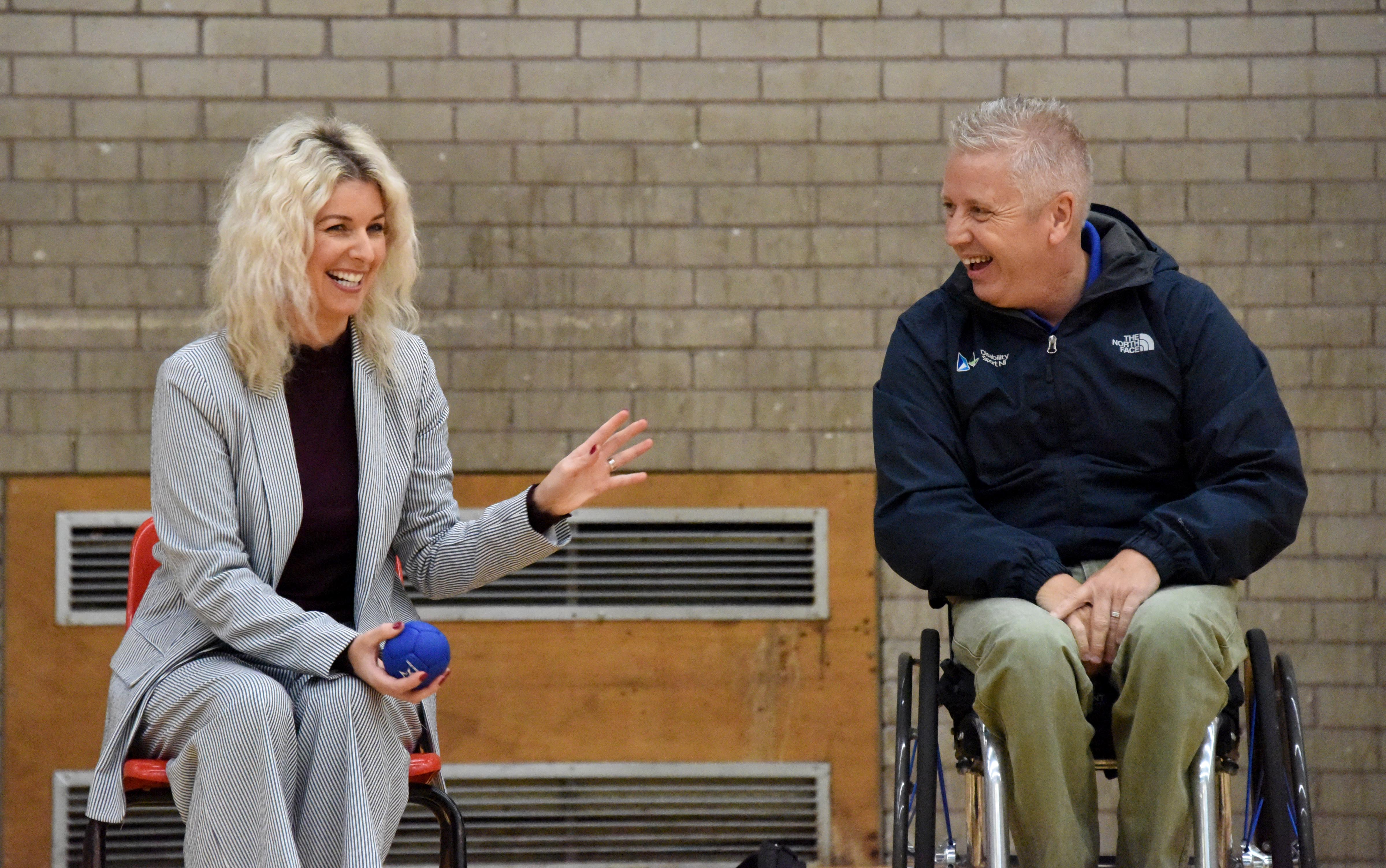 An image of Aubrey Bingham from Disability Sport NI and Lynne Lyness from Progressive Building Society playing Boccia