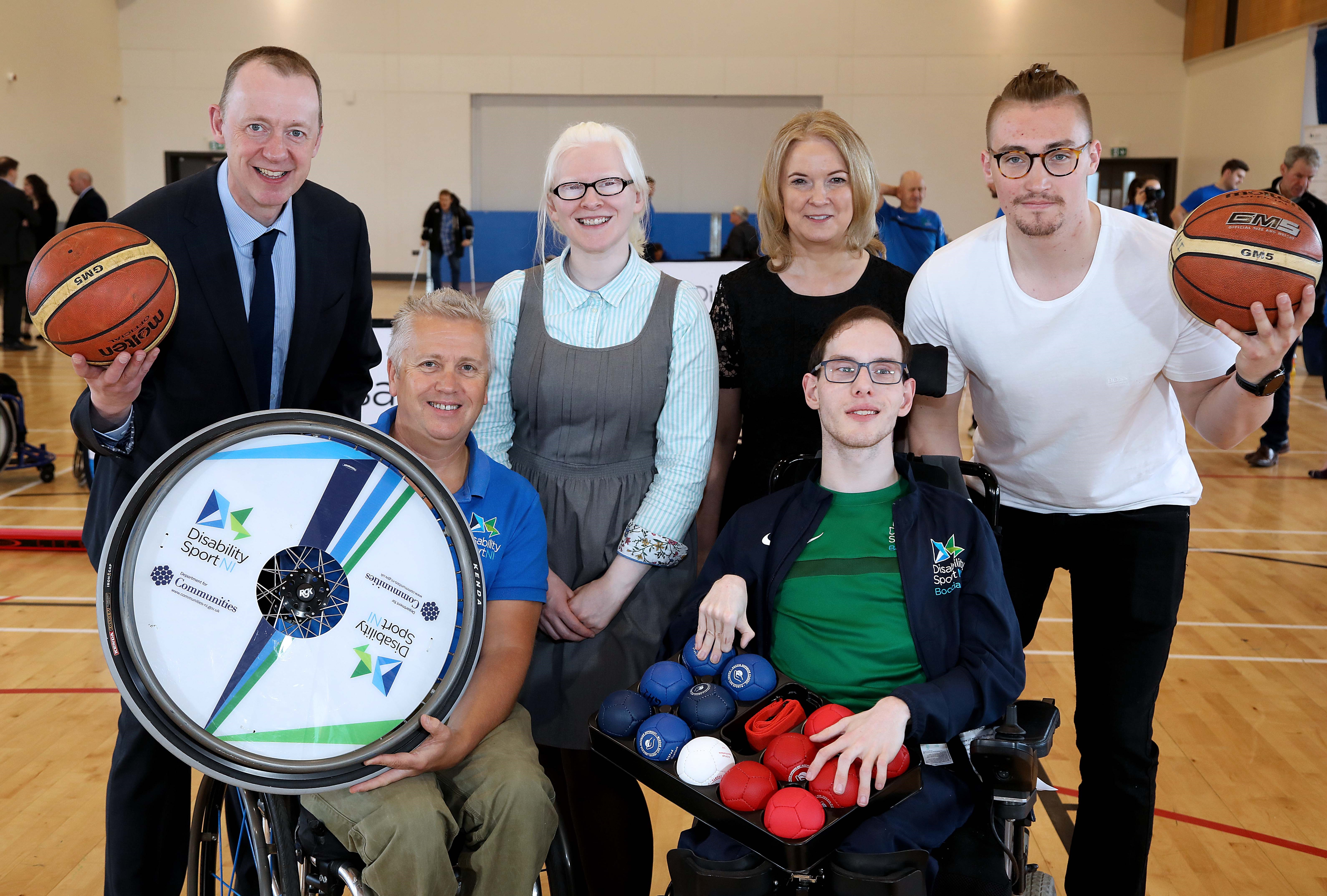 Image shows Kevin O'Neill, Aubrey Bingham, Kelly Gallagehrr MBE, Darina Armstrong and Ross Davidson holding basketballs
