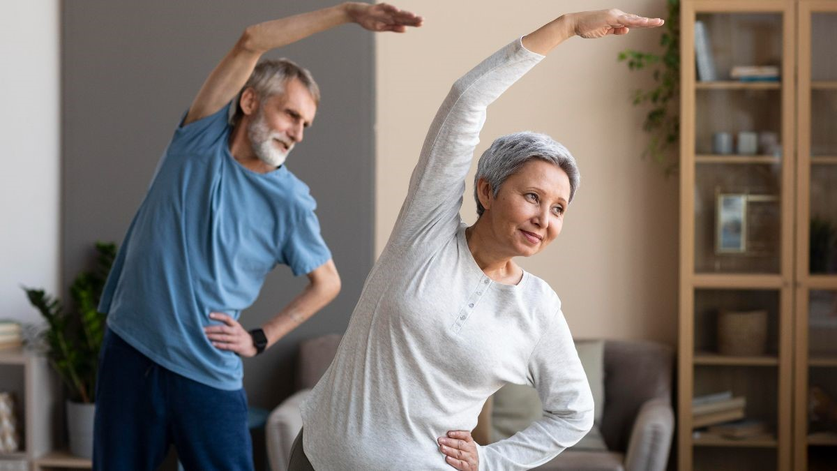 A couple in their home doing Tai Chi