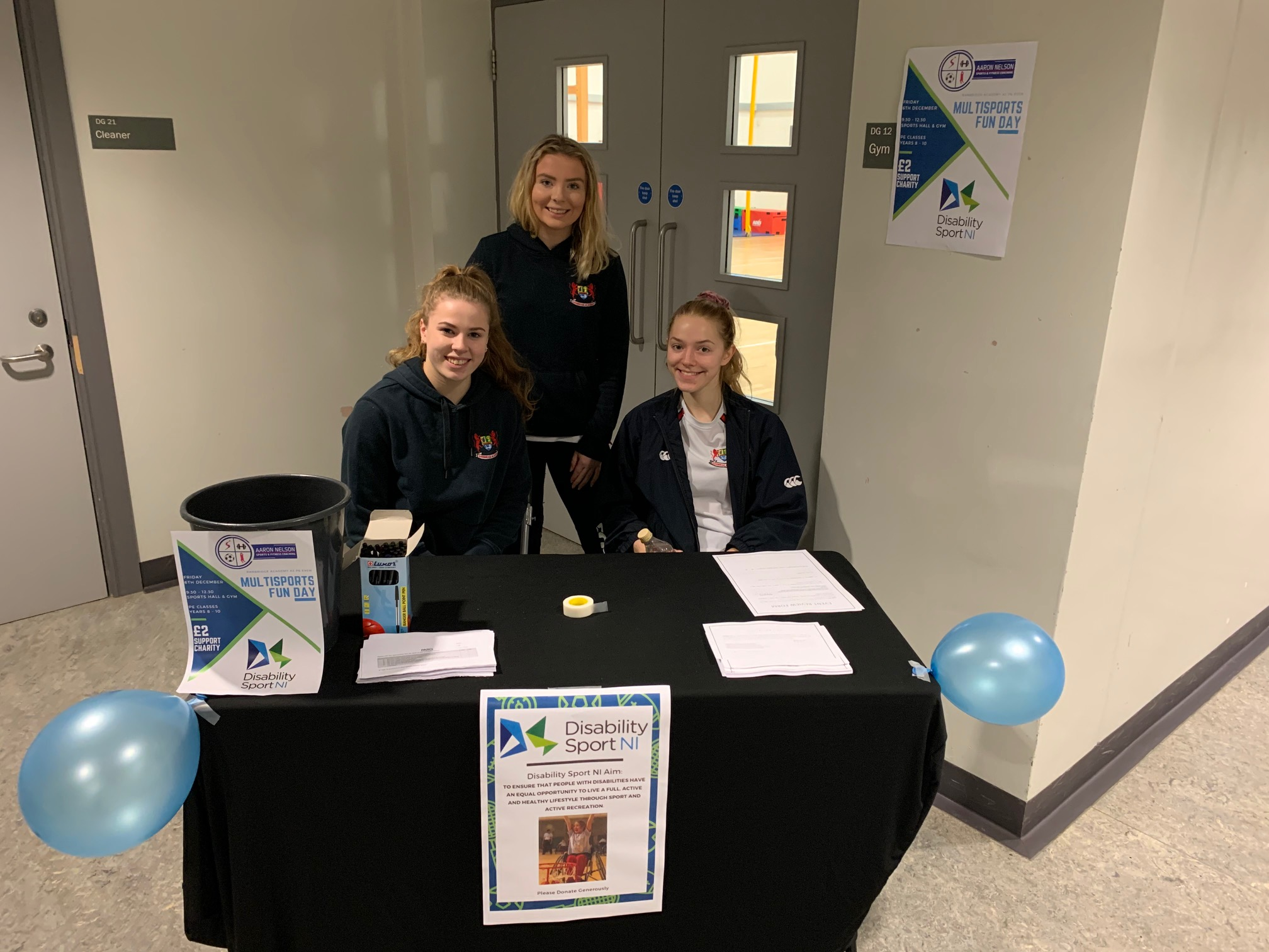 Young people at a fundraising table